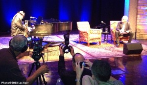Dr. John plays as interviewer Nick Spitzer watches