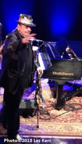 Dr. John exits waving to a crowd on its feet